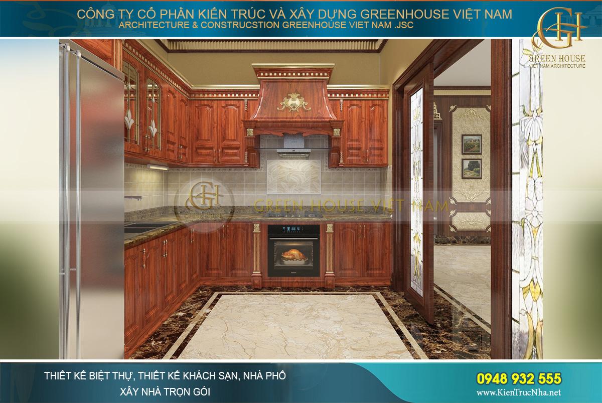 Thiết kế nội thất phòng bếp tân cổ điển với chất liệu gỗ đỏ cao cấp.